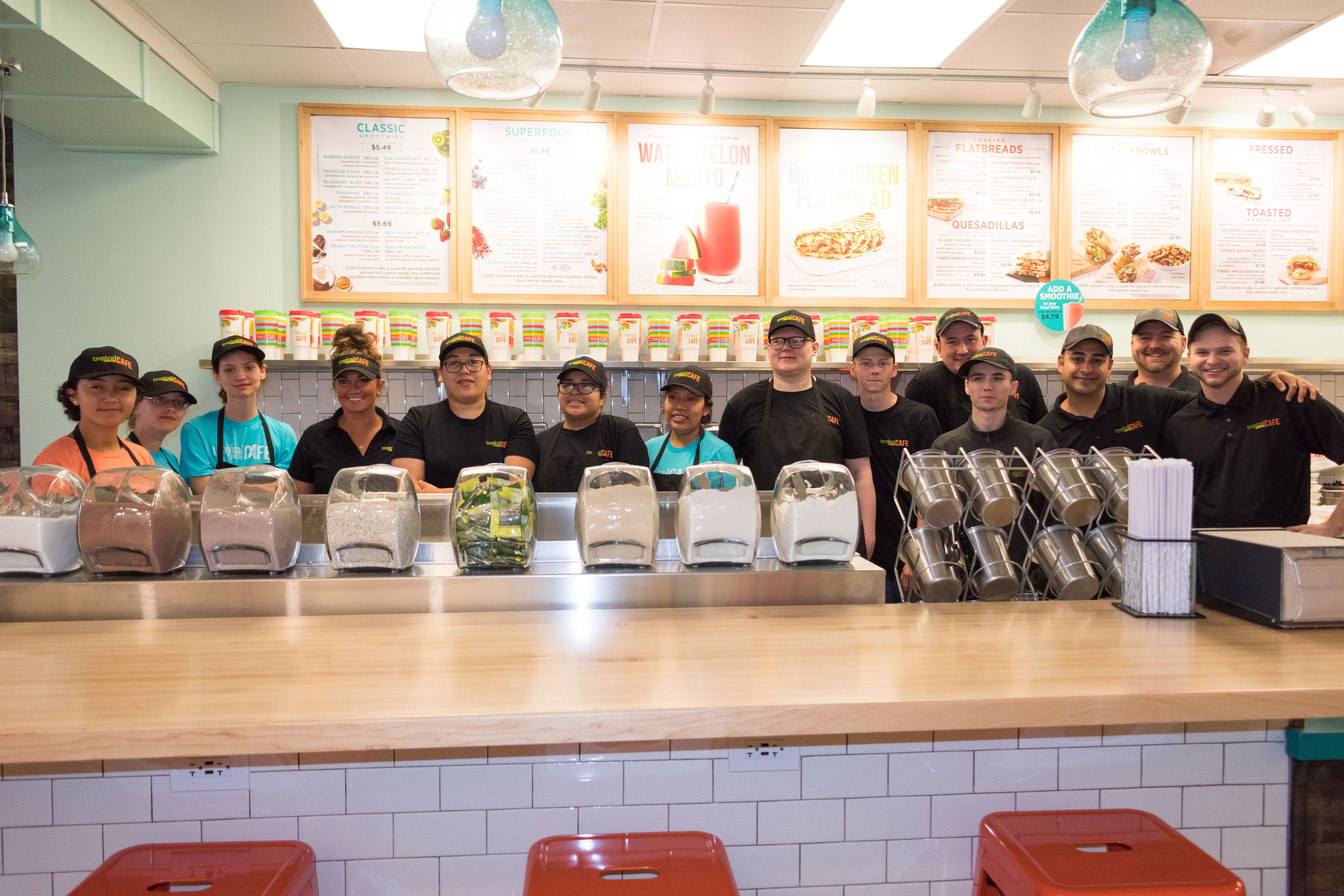 Staff inside a newly opened Tropical Smoothie Cafe