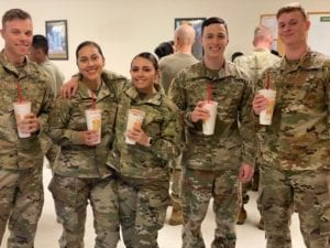 military employees enjoying gifted smoothies from local franchisees