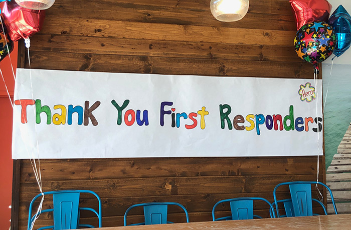 "Handmade sign saying ""Thank You First Responders"""