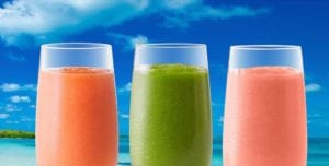 3 Smoothie glasses with a beach sky backdrop