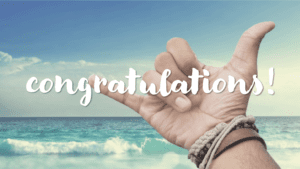 Hang loose hands with Congratulations with a beach background