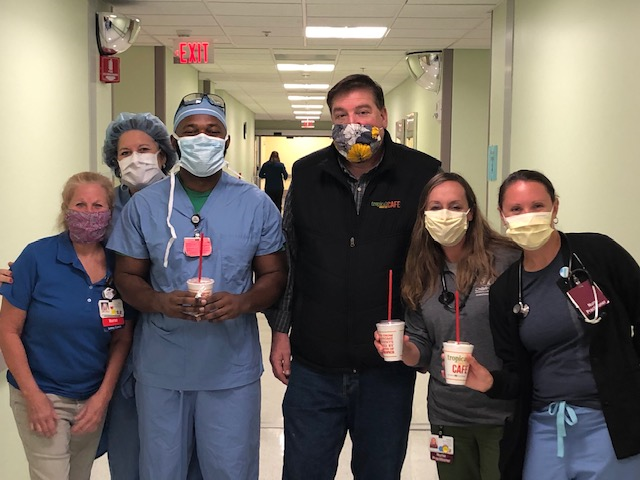 Tropical Smoothie Cafe workers delivering smoothies to hospital