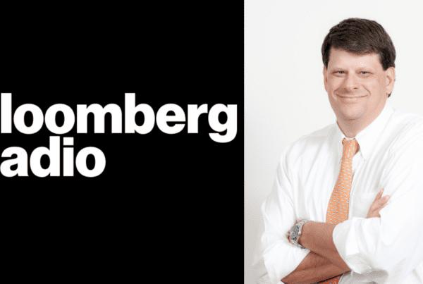Bloomberg Radio logo split screen with Charles Watson headshot