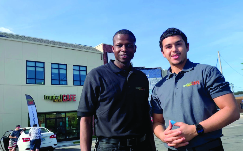 marlon and cesar, tropical smoothie cafe franchise owners standing outside their location